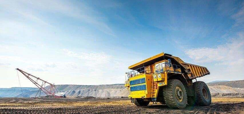 Automatic lubrication for rigid dump trucks