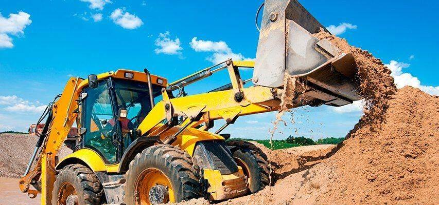 Backhoe loader in earthmoving operation