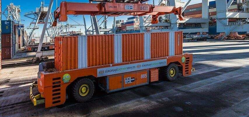 Automated guided vehicle and spreader in port operation, both automatically lubricated